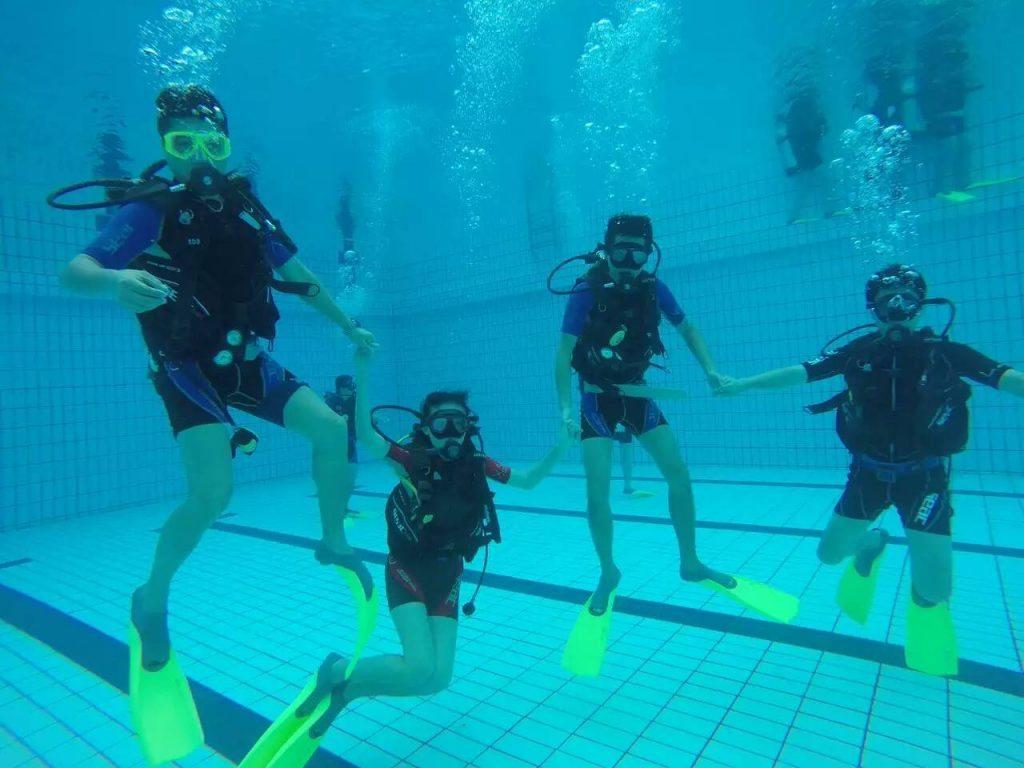 Enjoying Scuba diving- Pool session